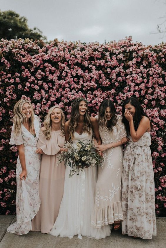 a lush pink flower wall is a dreamy wedding backdrop for the cermeony, photos and even your reception