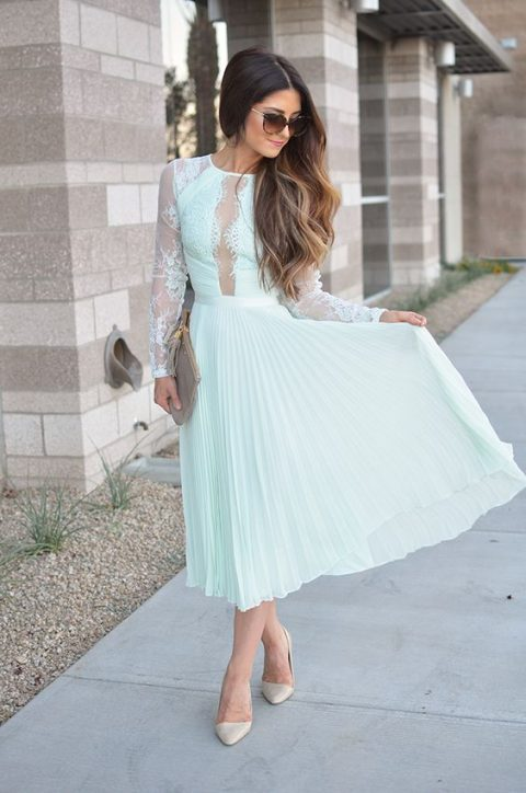 a mint midi dress with a lace bodice, a pleated skirt and long sleeves, nude shoes