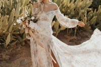 a pastel off the shoulder floral A-line wedding dress with long sleeves, a side slit and a train is a beautiful and chic idea