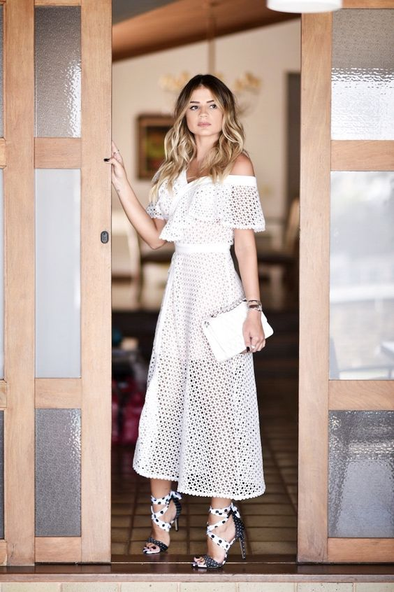 a perforated off the shoulder midi dress with a ruffle neckline, whimsy polka dot heels and a white mini bag