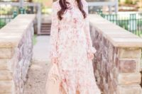 a pink floral midi dress with a high neckline, ruffles, long sleeves, nude shoes and a nude bag