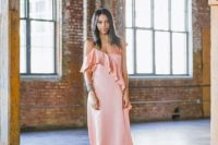 a pink spaghetti strap midi dress with ruffles, a statement bracelet and white shoes