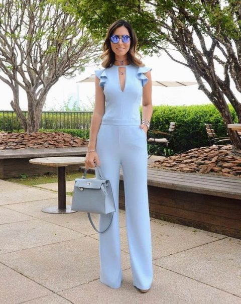 a powder blus jumpsuit with ruffled detailing on the shoulders is a chic spring like idea