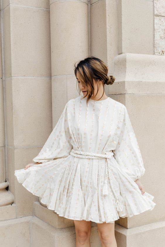 a pretty a-line embellished mini dress with puff sleeves, a high neckline and a pleated skirt plus a rope sash