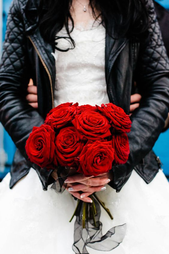 a red rose Valentine's Day wedding bouquet is a refined and chic idea for a bride