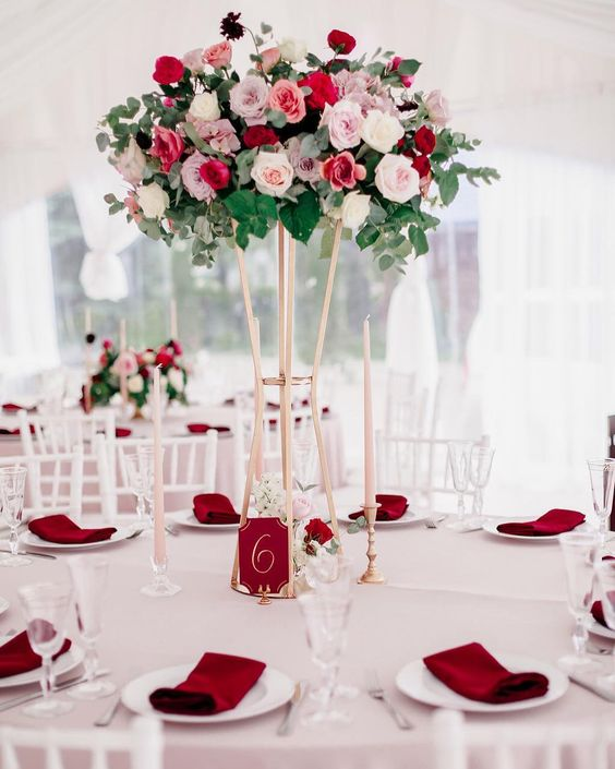 a refined floral wedding centerpiece of blush, white, lilac and red blooms and foliage and eucalyptus for Valentine's Day