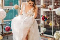 a romantic A-line wedding dress with a lace applique bodice, layered skirt, thick straps and a V-neckline plus metallic boots