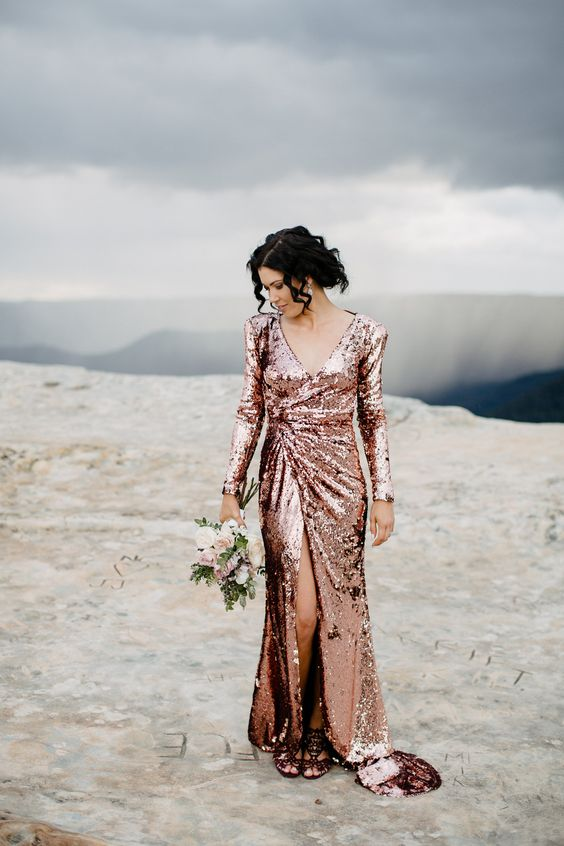 a rose gold sequin A-line wedding dress with a slit, a V-neckline and long sleeves is a timeless idea to rock