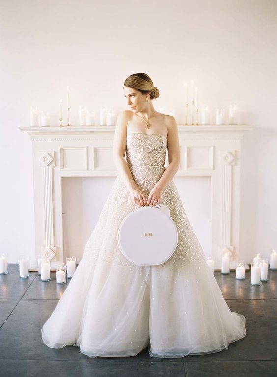 a strapless wedding ballgown, almost fully embellished with warm-colored rhinestones is a statement idea for a Valentine's Day wedding