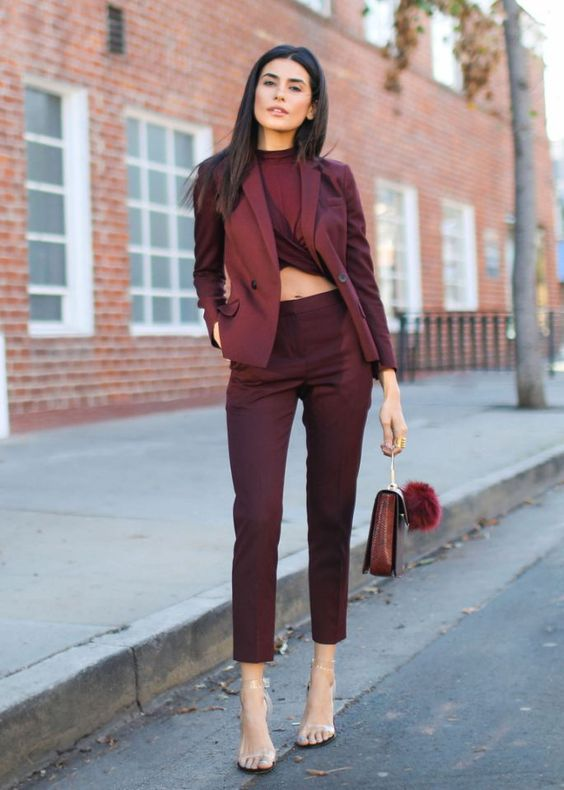 a total burgundy look with a twisted crop top, high waisted pants, a blazer, a bag, sheer shoes