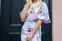 a white floral print over the knee dress with ruffled sleeves and a high neckline, a box bag and sunglasses