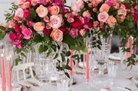 an exquisite Valentine's Day wedding tablescape in neutrals, with bold floral arrangements, pink candles and gold cutlery