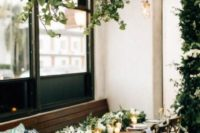 cascading greenery hangings plus some lanterns and matching centerpieces for a homey feel in your reception