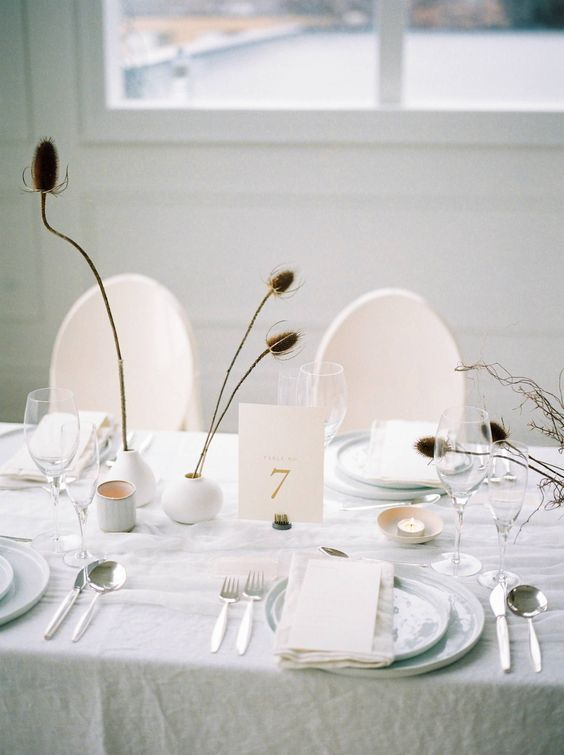 dried flowers in simple matte white vases will be a nice decoration with a subtle fall feel