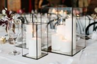 geometric black candle lanterns with white pillar candles are all that you need to create a mood and add to the decor