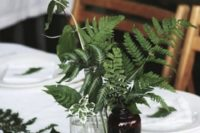 some ferns in vintage apothecary bottles are great for a woodland wedding, add figs for more interest