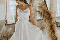 a beautiful and simple bridal separate with a silk spaghetti strap top and a lace A-line maxi skirt with a train