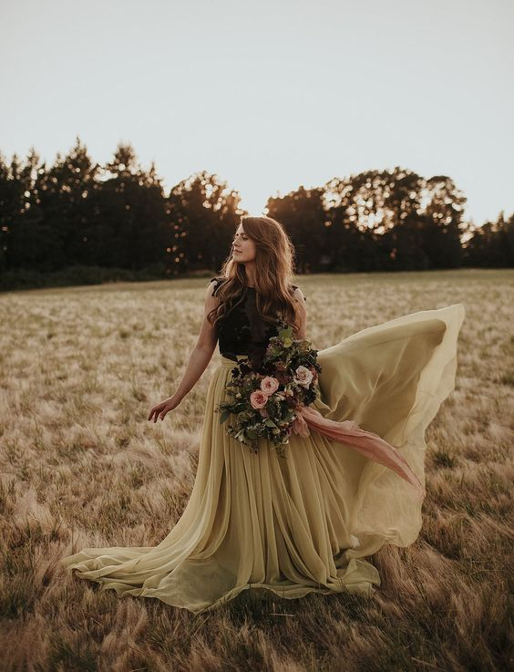 a black lace sleeveless top, a pistachio green flowy skirt with a train for a bold fall bridal look