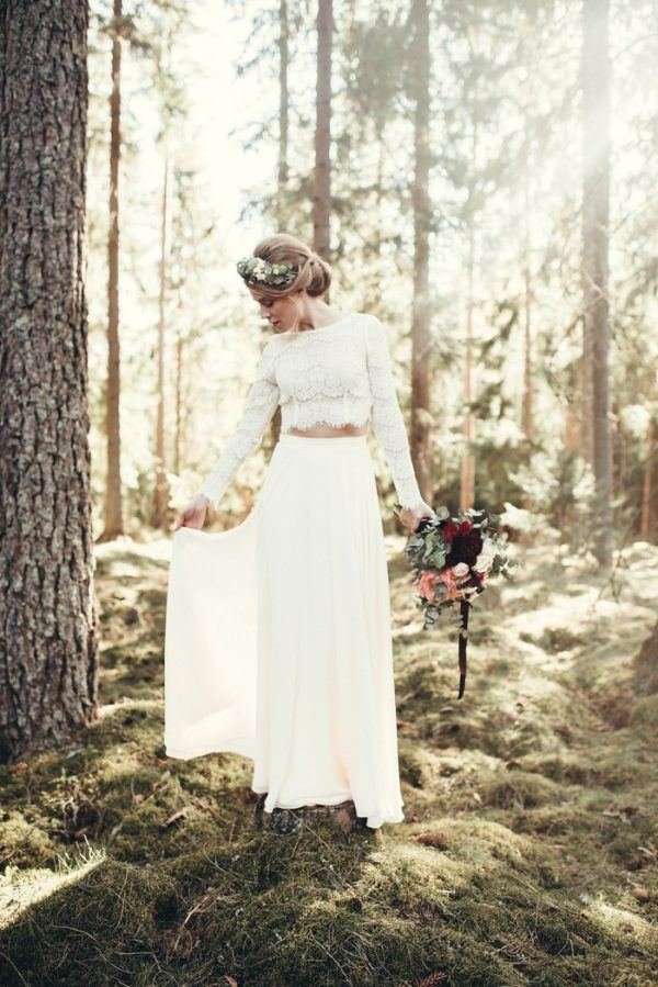 a boho bridal separate with a plain skirt and a lace crop top with long sleeves plus a high neckline