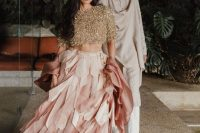 a bold gold glitter crop top with short sleeves and a pink layered skirt with petals make up a fantastic bridal look