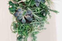 a cascading greenery wedding bouquet with lots of succulents of various shades looks wow