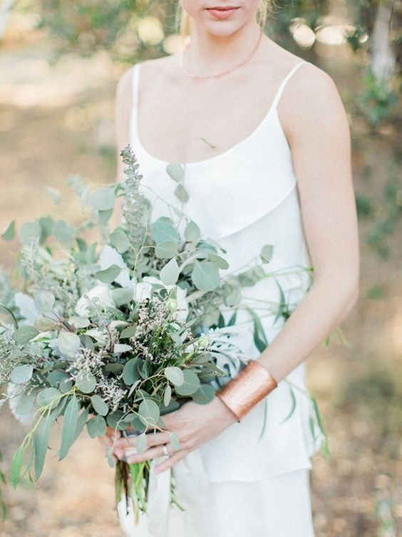 a casual greenery wedding bouquet of eucalyptus and some blooming branches looks very chic