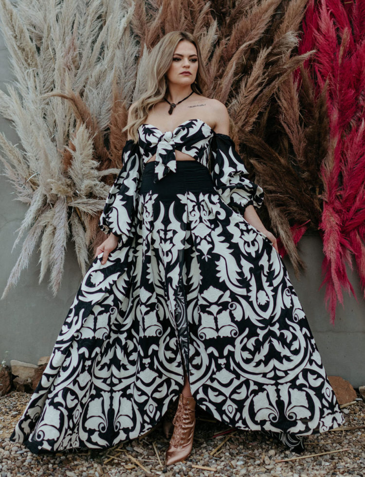 a fantastic black and white wedding dress with an off the shoulder bodice and a maxi skirt plus blush satin booties