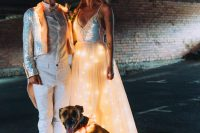 a fantastic lit up wedding dress with an iridiscent bodice and a light up skirt and a gorgeous crown