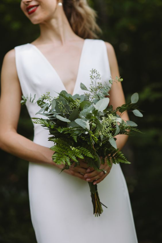 a greenery wedding bouquet with ferns and eucalyptus is a cool idea for a modern or minimalist bride
