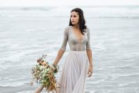 a grey lace bodysuit with a deep neckline and long sleeves and a flowy blush maxi skirt for a romantic look