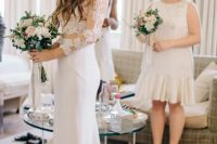 a lace crop top with long sleeves and a plain mermaid skirt with a train for a fashionable bride