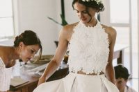 a lace halter neckline crop top and a full pleated maxi skirt for a unique and very eye-catchy bridal look