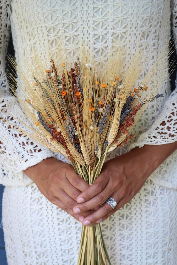 a lovely dried flower and wheat wedding bouquet will fit a boho bridal look in summer or fall