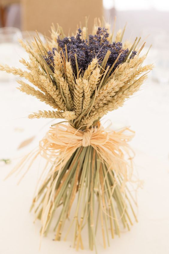 a lovely wheat and lavender arrangement can work as a centerpiece or decoration without a vase as it's all-dried