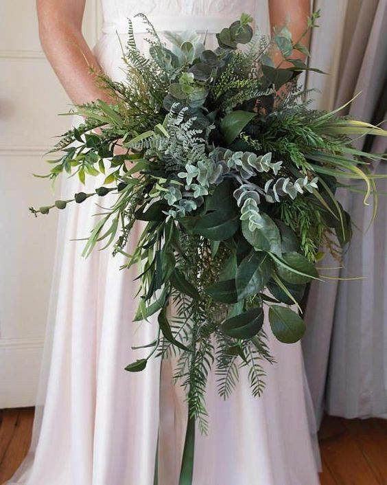 a lush textural and cascading wedding bouquet with pale greenery, ferns, foliage and other stuff