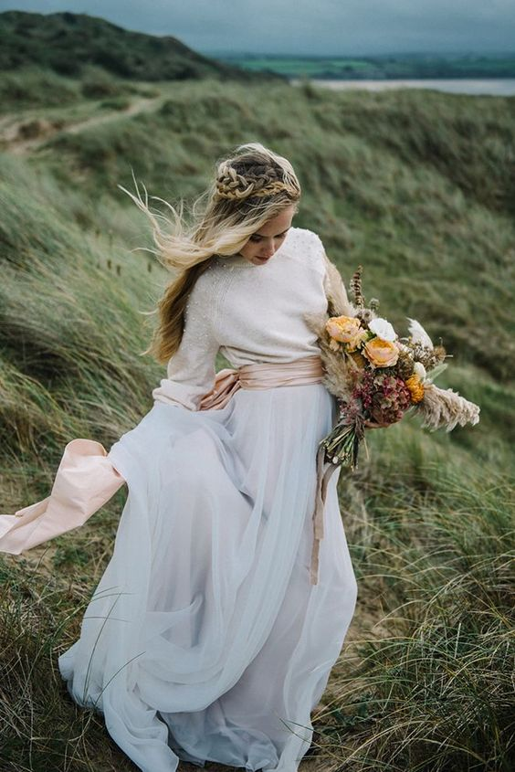 a pearled sweater, a wide blush sash and a layered tulle maxi skirt for a casual and boho bride