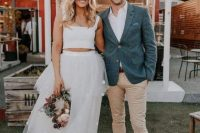 a plain crop top with thick straps and a square neckline plus a polka dot layered maxi skirt for a modern and playful bride
