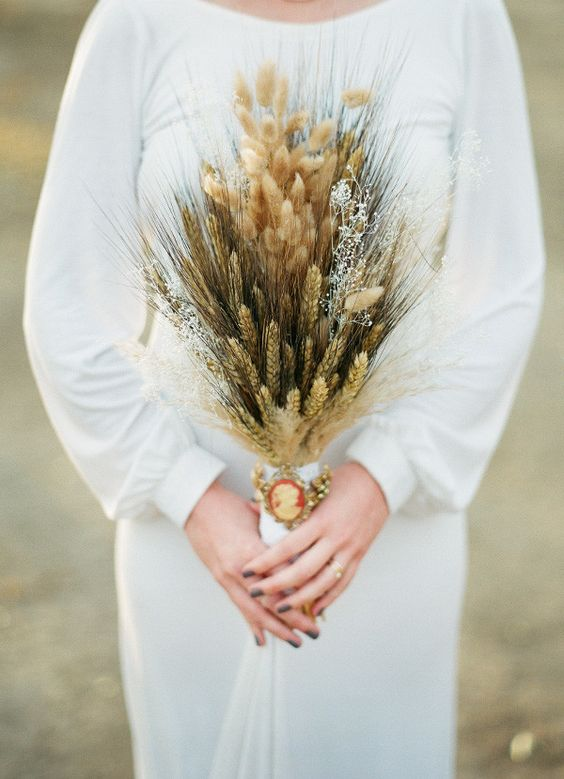 a rustic fall wedding bouquet with wheat, bunny tails, various grasses will fit a boho or rustic wedding