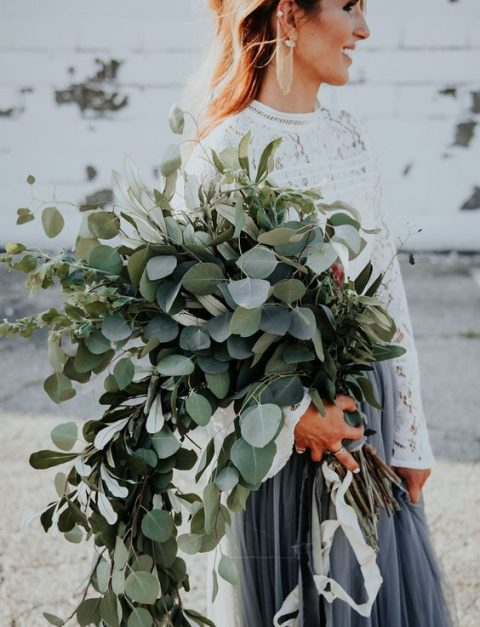 a super lush oversized cascading greenery wedding bouquet to make a statement with your bridal look