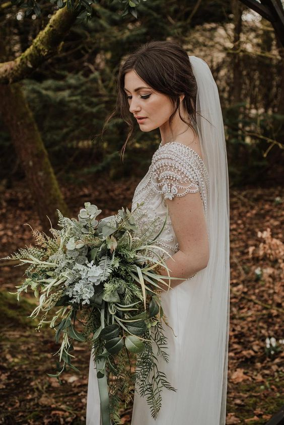 a textural forest greenery wedding bouquet with ferns, grasses, pale greenery and succulents is a fresh idea
