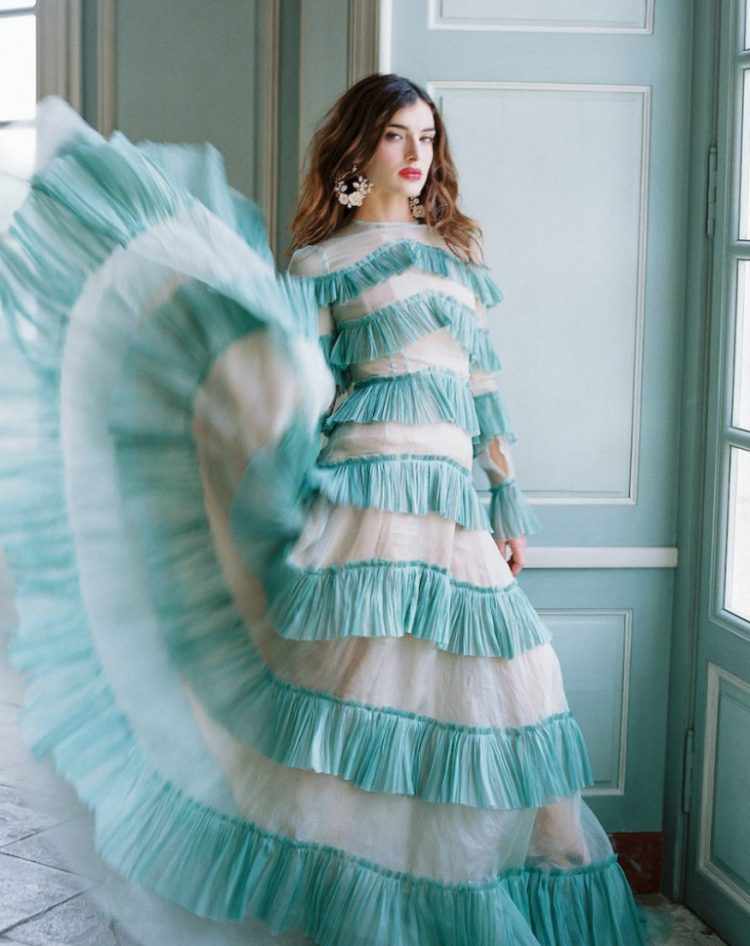 a unique mint ruffle wedding dress with long sleeves and a high neckline is a bold option for a non traditional bride