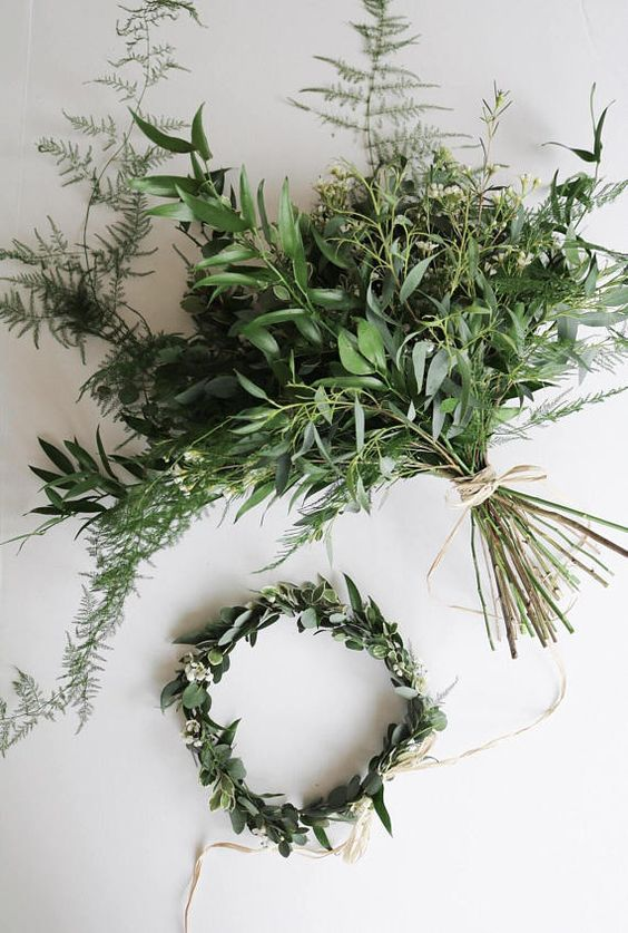 a very textural forest-inspired wedding bouquet including olive branches looks wild and bold