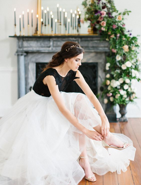 a white full skirt and a black lace applique bodysuit for a bold and contrasting look at the wedding