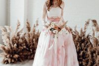 a white lace crop top with long sleeves paired with a pink marble full skirt with a train for a romantic and girlish look