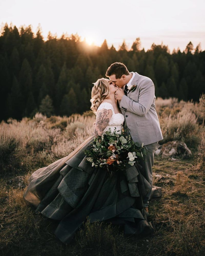 a white lace top with cap sleeves and a full black skirt with lots of ruffles is a gorgeous contrasting outfit to tie the knot