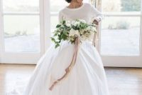 a white layered skirt, a creamy top with an spaghetti strap one under it for a modern or casual bride