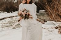 a white oversized sweatshirt and a lace maxi skirt with a train, silver shoes and a turban for a casual bride
