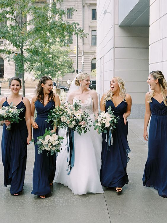 navy draped A-line bridesmaid dresses and a white wedding dress will keep your wedding color scheme up