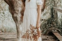 a boho chic off the shoulder empire waist wedding dress with lace looks effortless and romantic