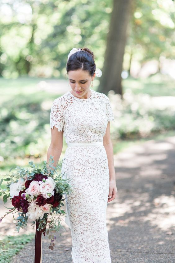 a boho lace fitting wedding dress with a high neckline, short sleeves looks bold and statement